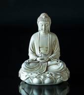 Sitting Buddha on lotus in white