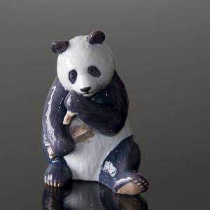 Panda eating bamboo looking content, Royal Copenhagen figurine