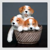 Puppies in a basket looking sweet, Royal Copenhagen dog figurine