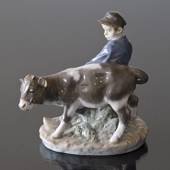 Boy walking to the field with Calf, Royal Copenhagen figurine no. 772