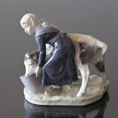 Girl feeding a Calf from a bucket, Royal Copenhagen figurine no. 779