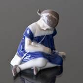 Girl with Doll sitting on her side, Bing & Grondahl figurine no. 1526