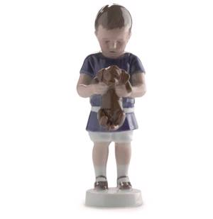 Boy holding a dog in front of him, Ole. Bing & Grondahl figurine no. 1747