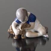 Boy hugging his Friend the Dog, Bing & grondahl figurine no. 1951