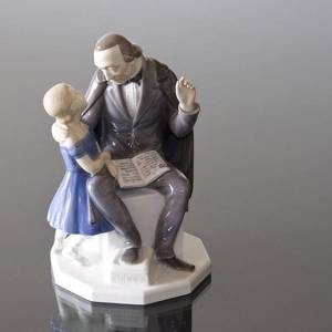 H. C. Andersen telling his stories to a girl, Bing & grondahl figurine no. 2037 | No. 1021445 | Alt. B2037 | DPH Trading