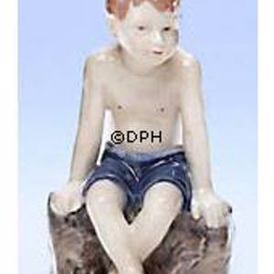 Jens sitting on a rock, The little beach lion, Royal Copenhagen figurine | No. 1021682 | DPH Trading