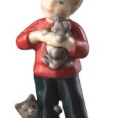 Boy standing with cat, mini figurine