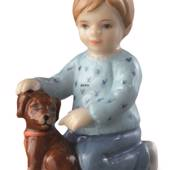 Boy sitting with dog, mini figurine