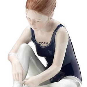 Ballerina sitting tying her shoes, Royal Copenhagen figurine