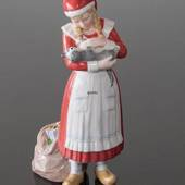 Christmas girl petting her cat, Royal Copenhagen Christmas figurine
