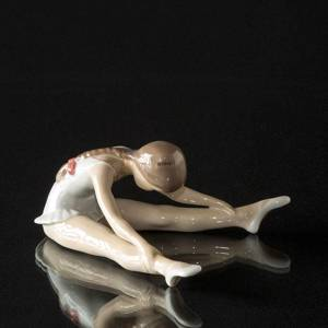 Sitting ballerina bending forward, Royal Copenhagen figurine | No. 1249329 | DPH Trading