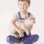 Boy with piglet, Royal Copenhagen figurine