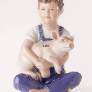 Boy with piglet, Royal Copenhagen figurine | No. 1249436 | DPH Trading