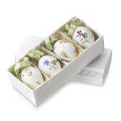 4 different easter eggs with spring flowers