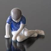 Boy sitting sadly looking at the ground, Bing & Grondahl figurine No. 1671