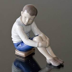 Boy sitting on books, Little professor, Bing & Grondahl figurine