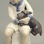 Boy sitting with Dog, Bing & Grondahl figurine No. 2201