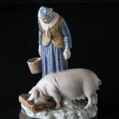 Woman with pig, Bing & Grondahl figurine