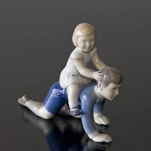 Riding, Children playing, big brother little sister, Bing & Grondahl figurine No. 2303 | No. B2303 | DPH Trading
