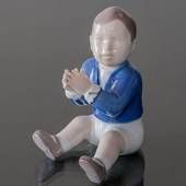 Boy sitting clapping his hands, Bing & Grondahl figurine No. 2337