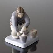 Greenlandish woman with bucket pouring water in, Bing & Grondahl figurine