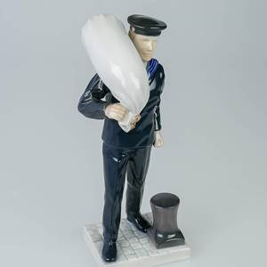 Mariner in service uniform with sailor's bag, Bing & Grondahl figurine,