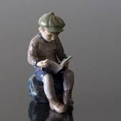Boy, sitting reading, figurine Dahl Jensen