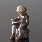 Boy sitting reading figurine Dahl Jensen, brown colours No. 1096