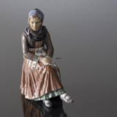 Woman sitting in National Costume figurine Dahl Jensen No. 1110