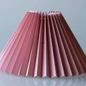 Pleated lamp shade of rose coloured chintz fabric, sidelength 25cm