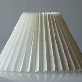 Pleated lamp shade of off white chintz fabric, sidelength 25cm