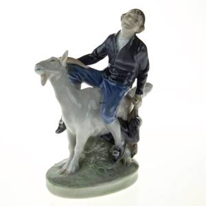 Hans Clodhopper, Boy riding on Goat, Royal Copenhagen figurine No. 1228 | No. R1228 | DPH Trading