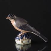 Redwing sitting on berries, Royal Copenhagen figurine No. 1235