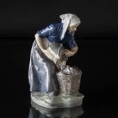 Woman collecting Potatoes, Royal Copenhagen figurine