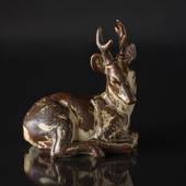 Stag lying down relaxing, Royal Copenhagen stoneware figurine no. 21433