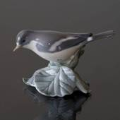 Flycatcher sitting in leaves, Royal Copenhagen bird figurine No. 2144