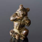 Sitting bear licking its paw, Royal Copenhagen stoneware figurine No. 21675