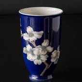 Vase with white flower on strong blue background, Royal Copenhagen