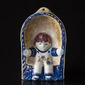 Boy in Wicker Chair Faience figurine from Royal Copenhagen