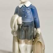 Boy with briefcase, June, Royal Copenhagen monthly figurine No. 4528