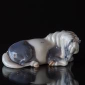 Shetland pony lying down, Royal Copenhagen horse figurine No. 4611