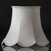 Octagonal lampshade with curves height 22 cm covered with off white silk fa...