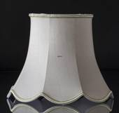 Octagonal lampshade with curves height 26 cm, covered with off white chintz...