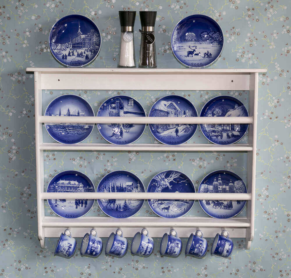 Hans Christian Andersen Plates in a white plate rack