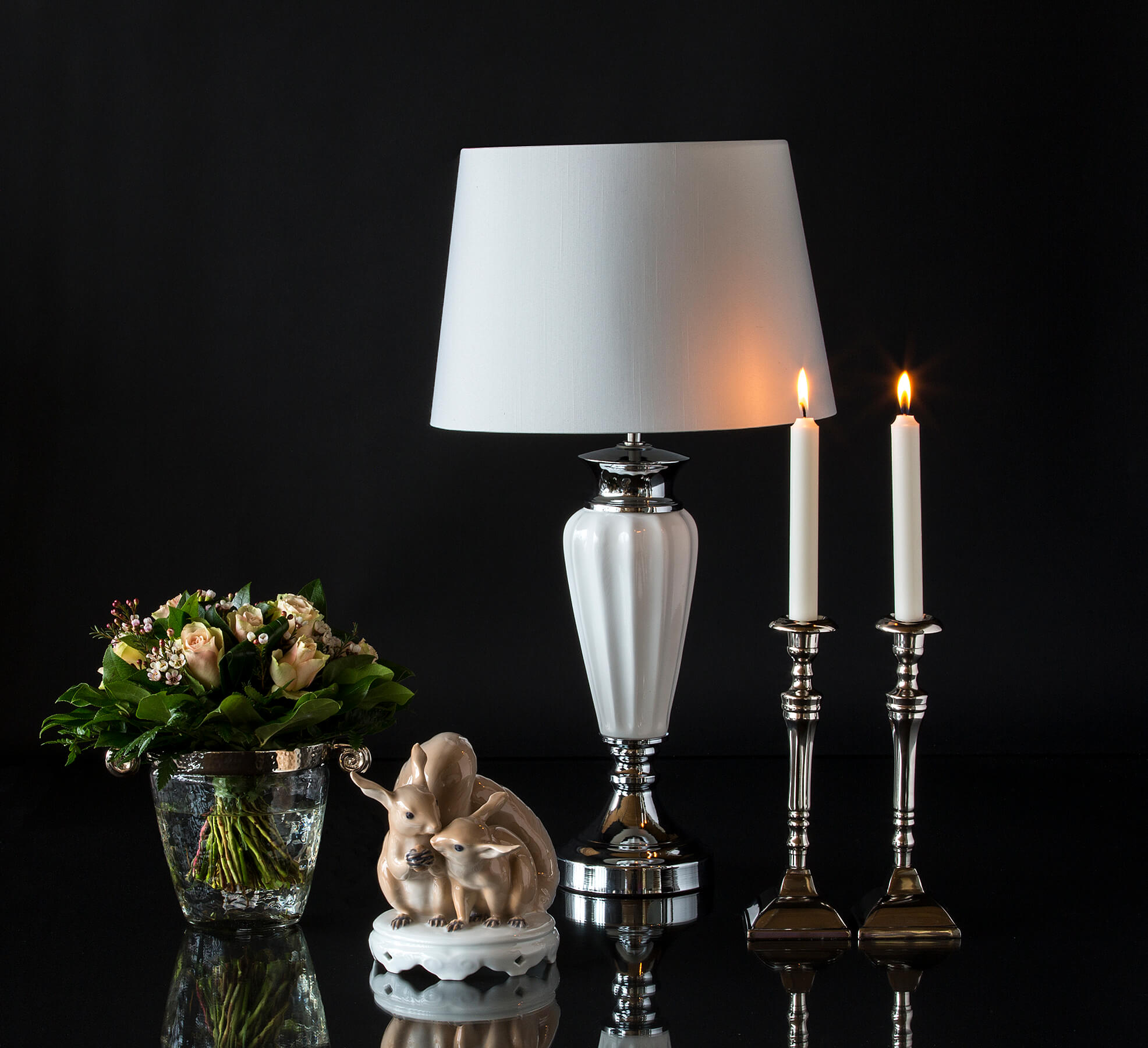 Figurine of squirrels with classic lamp and candlesticks