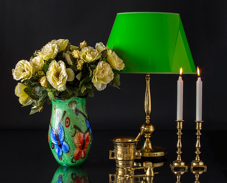 Green vase with butterflies that match the green lacquer lampshade on the brass lamp