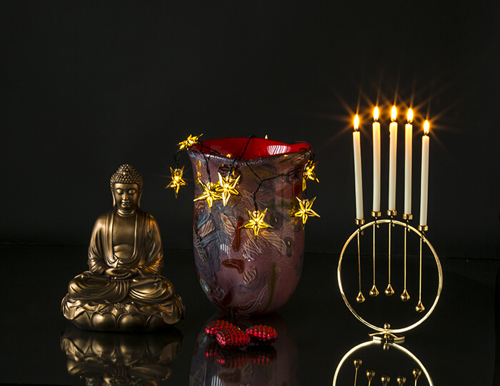 Large buddha together with red glass vase and Asmussen candleholders on round holder