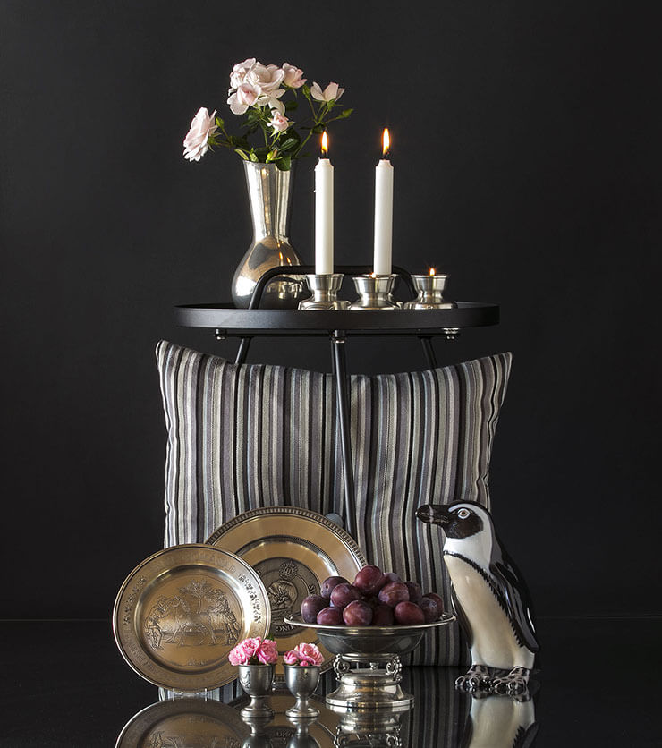 Pewter Tin plates together with pinguin figurine, Tin egg cups, tin candleholders and a tin vase