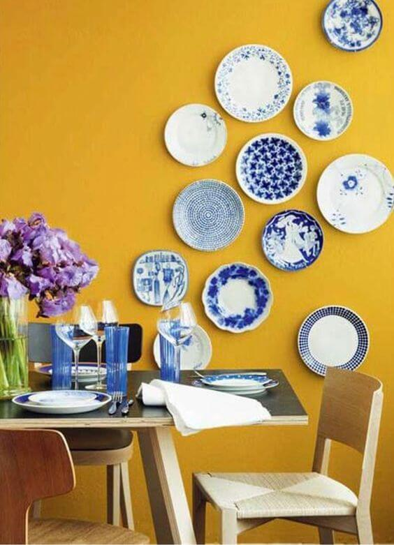 Plates on colorful wall