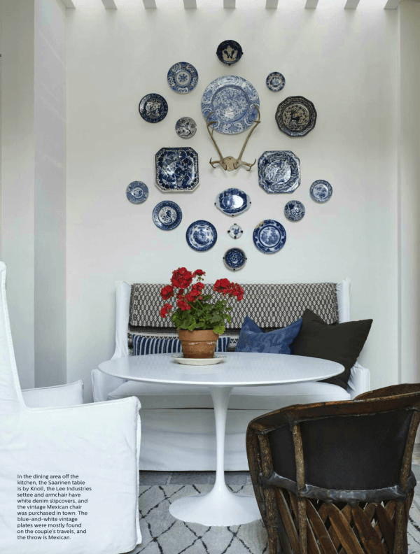 Plates in dinning room around antlers